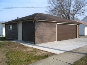 14. Completion of a custom Classic Builders  Deluxe Hip style garage.