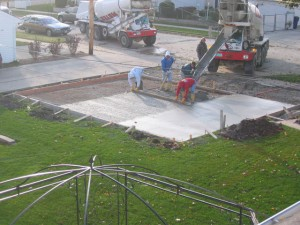 "6. Pouring of concrete foundation for  new garage. Concrete is 4"" thick."