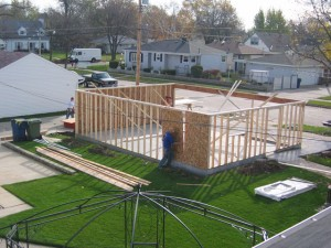 "9. Framing of stud walls. 2 x 4's at 16"" on-center and installation of OSB sheating."